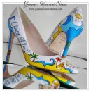 Seaside and shells hand painted on a pair of white wedding shoes