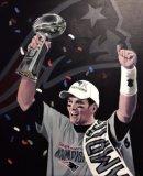 Tom Brady, New England Patriots NFL star holding aloft the Superbowl trophy in 2017