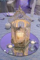 Birdcage draped in pearls