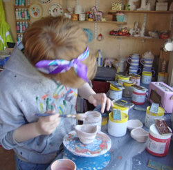 Glazing the buscuit fired ceramics
