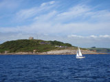 Sailing boat passes Pendennis castle Falmouth