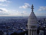 Eiffel Towel on a sunny misty Paris skyline from Sacre-Coeur