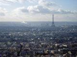 Eiffel Towel on a sunny misty Paris skyline