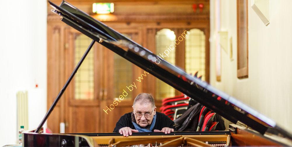 Irwin Schmidt prepping piano