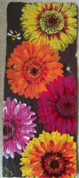 Gerberas on purple slate
