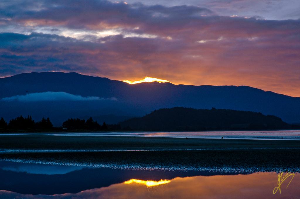 Sunset and Reflections at Pohara Beach