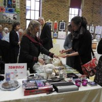 Maureen busy on the tombola stall. 2016
