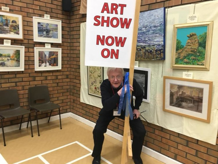 Frank getting to grips with his amazing sign. Exhibition 2017