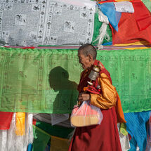 Nun with prayer wheel
