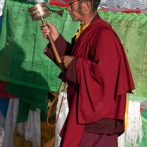 Monk with prayer wheel