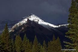 Snow capped peak in bad weather