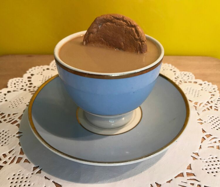 'Art Tea' blue cup with dunked Ginger Nut
