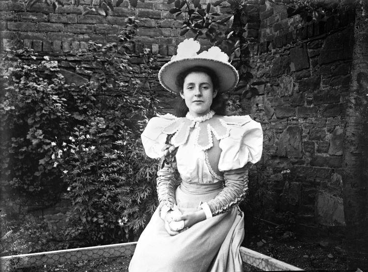 Portrait of a girl in a garden c.1903