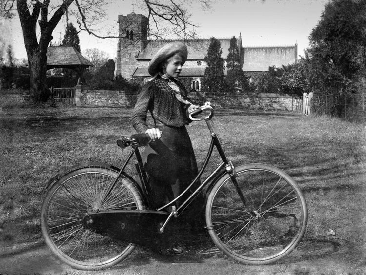 Portrait of a girl with a bicycle c.1908