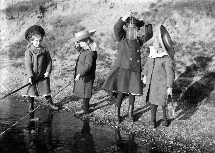 Children fishing in a pond c.1905