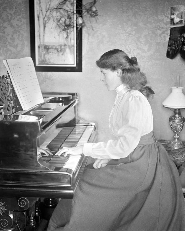 Portrait of a girl at a piano c.1903