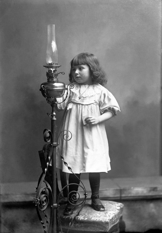 Portrait of a girl with an oil lamp c.1903