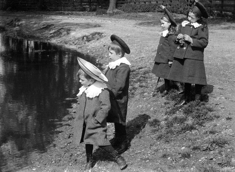 Children by a pond