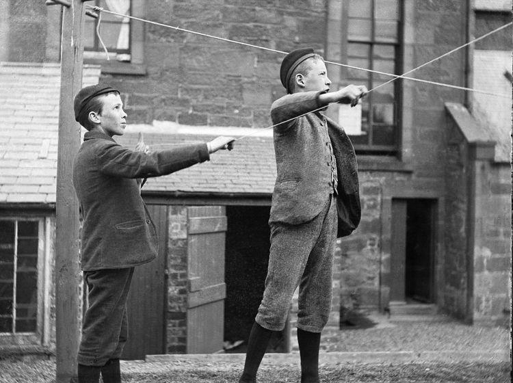 Boys flying kites c.1903