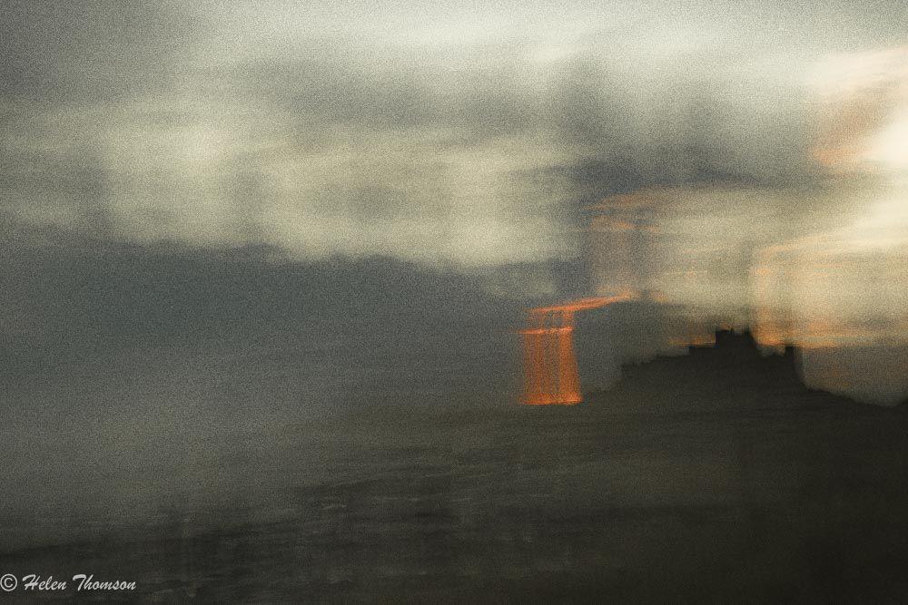 06101 'Firestorm over Bamburgh'