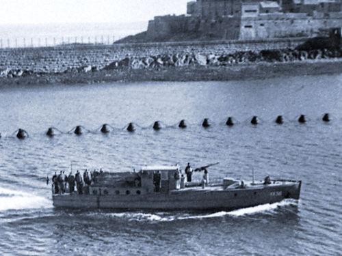 A German Boat enters St Peter Port Harbour.