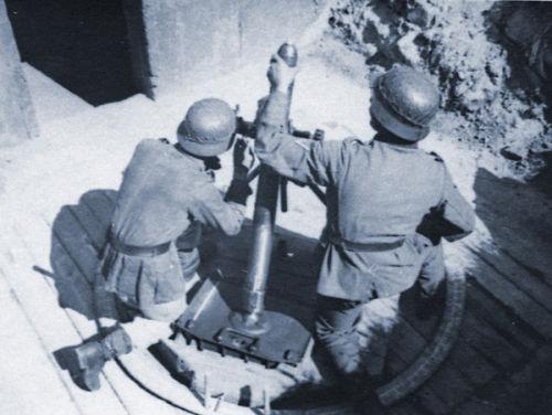 Troops firing a mortar.
