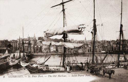 A Sailing ship loading in the old harbour.