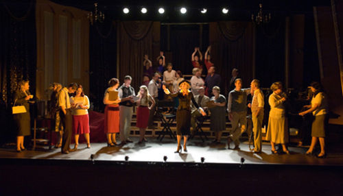 The cast on stage .