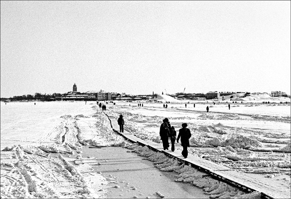 Sunday walkers on ice road from Suomenlinna