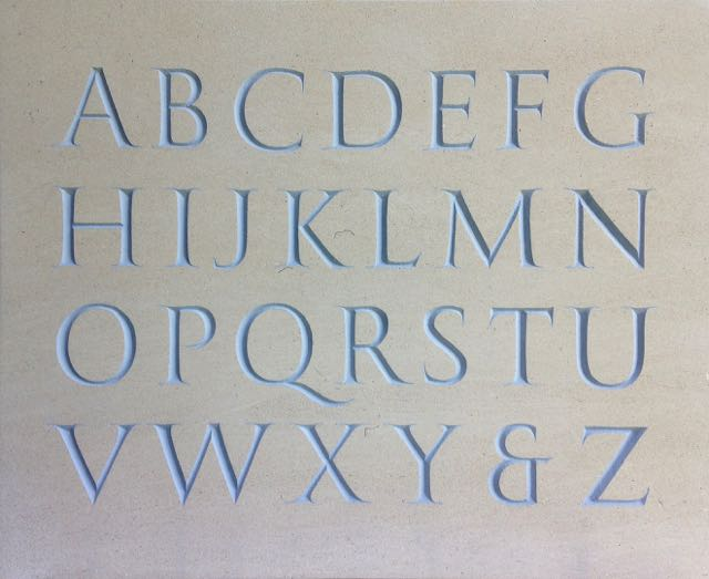 IAIN COTTON lettering carving sculpture: A carved Roman