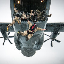Military freefall from a Hercules flying in the rain over Germany