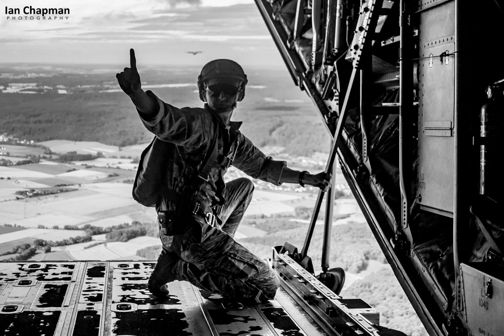 One Minute! The jump master aboard a Hercules signals one minute to jumping over Germany