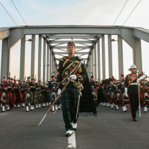 The Pipes and Drums march across the John Frost bridge, Arnhem, Holland