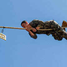 A US Army Ranger tackling an obstacle course at Fort Benning, Georgia