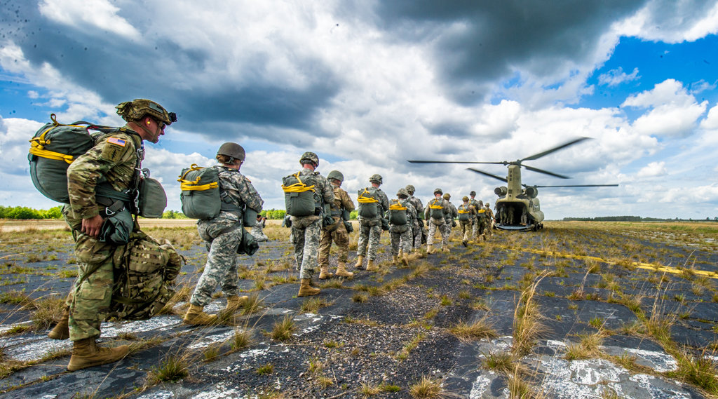 Jumpers prepare to board a Chinook helicopter on a drop zone in Georgia, USA