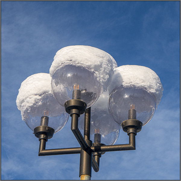 Snowcapped streetlights