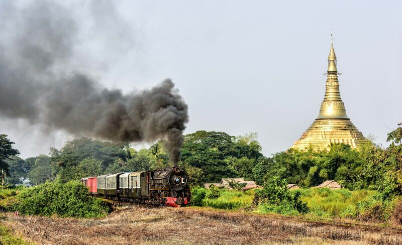 YC 629 passing a temple on the mainline near Bago