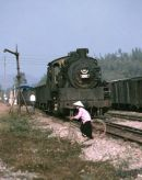 GP6 class 2-8-2 1040 with 10 bogie loaded coal wagons between Kep and Hanoi Yen  Vien.