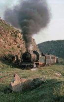 2-8-0 No 162, built by A Borsig in 1914 is seen climbing out of the Yarmuk gorge.