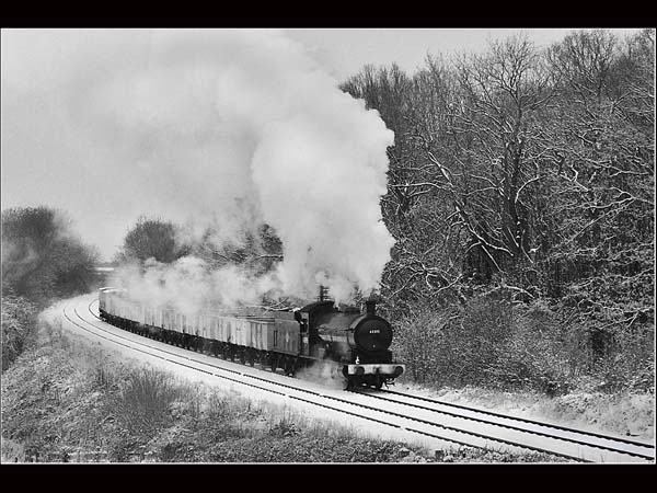 Freight train on the Great Central Railway 63395.