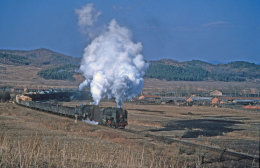 A mixed freight tackles the climb to the summit