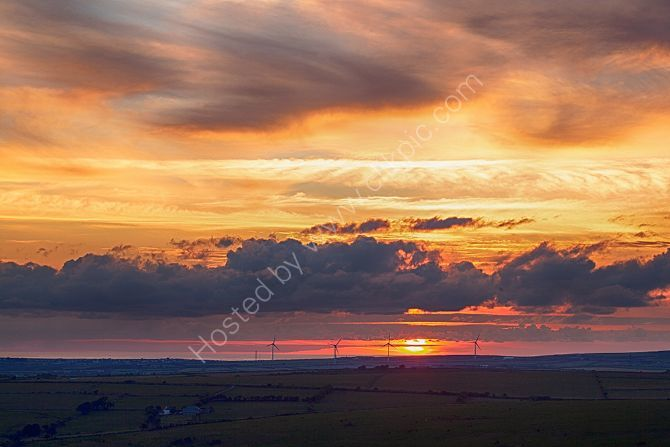 Golden sun set over Camelford from Rough Tor Bodmin Moor Cornwall