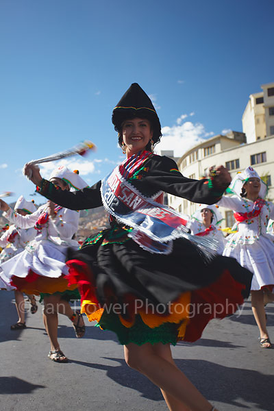 Woman dancing at festival, La Paz