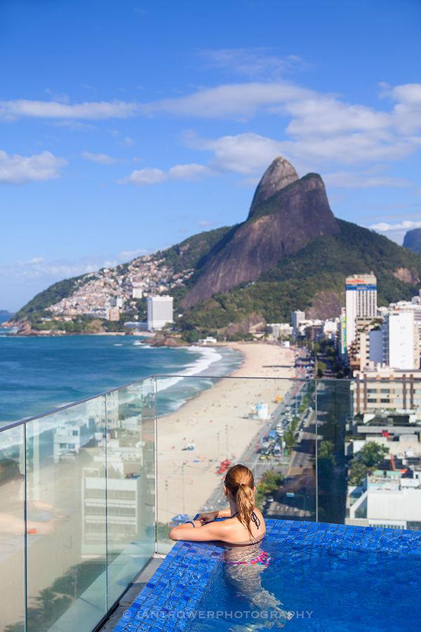 Women in rooftop pool, Ipanema beach, Rio de Janiero, Brazil