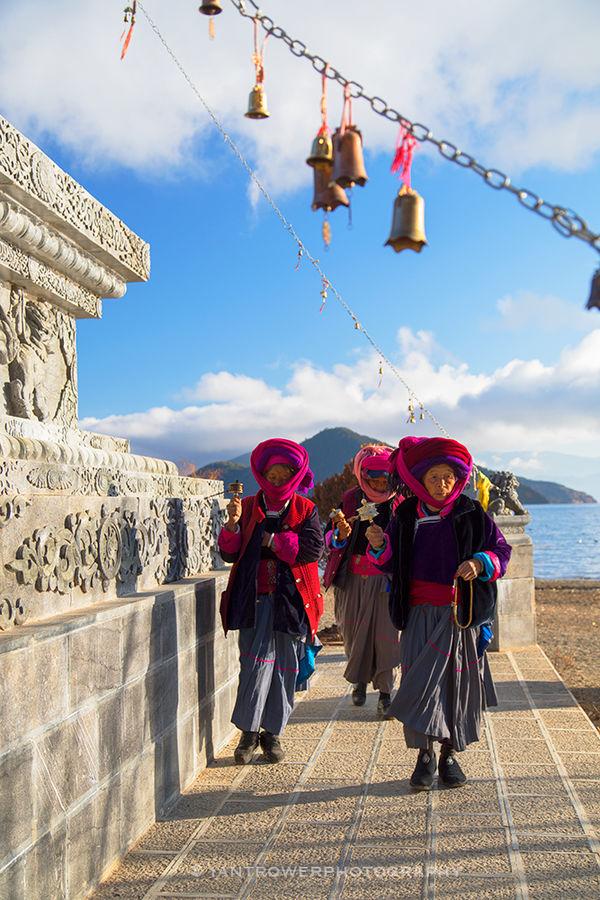 Women praying at stupa, Lugu Lake, Yunnan, China