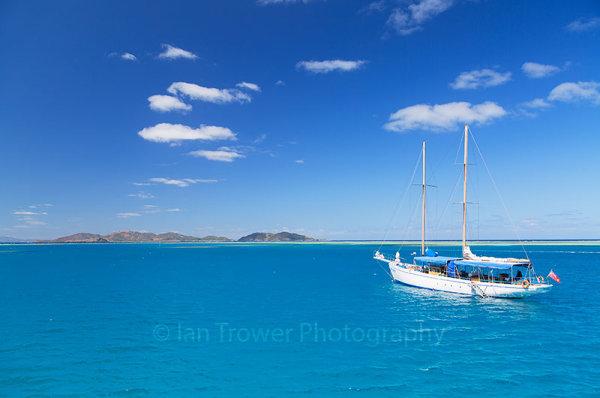Yacht in lagoon, Mana Island