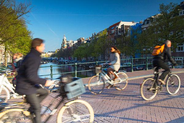 Cyclists crossing bridge, Amsterdam, Netherlands