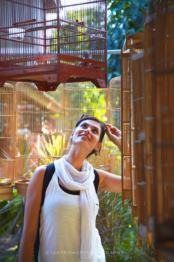 Woman at bird market, Yogyakarta, Indonesia