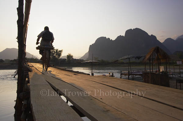 Cyclist On Bridge, Vang Vieng