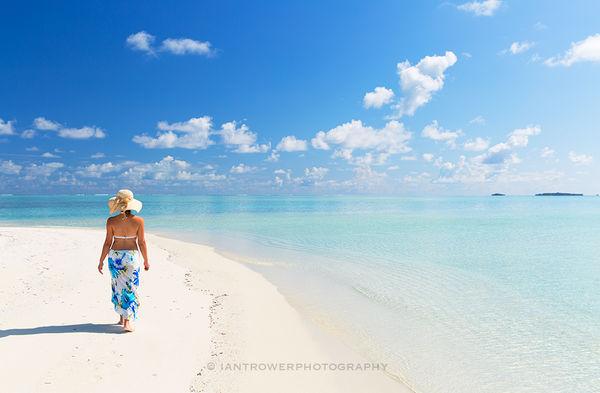 Woman on beach, Maldives